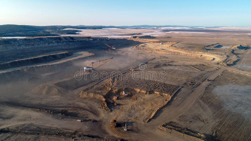 Coal mining in open pit. Excavator dust stock photography