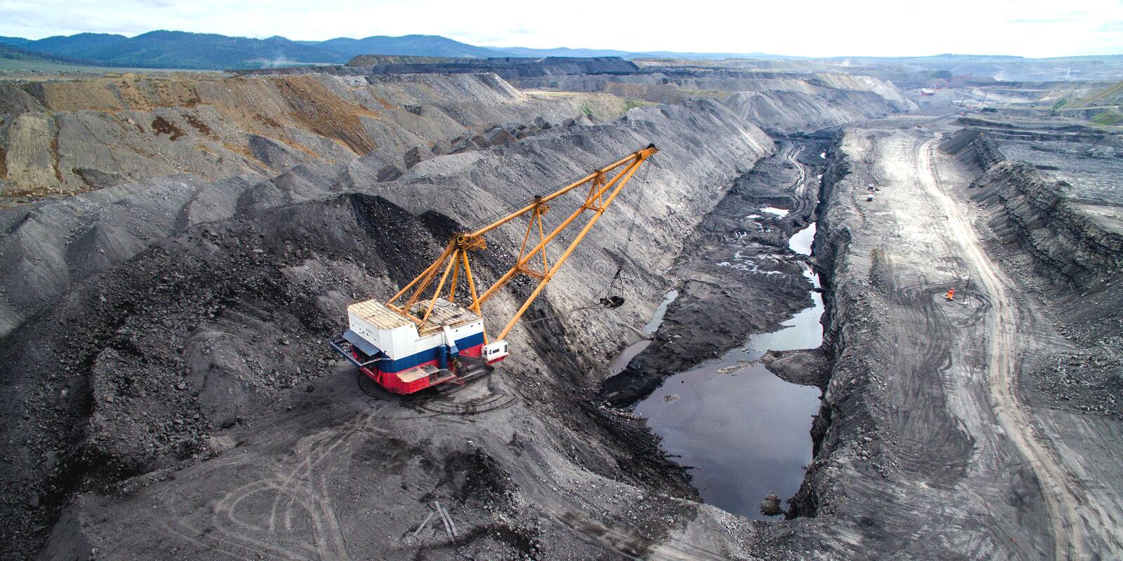Coal mining in open pit. Dragline on open pit coal mine in Russia stock images