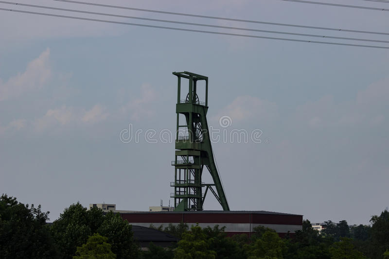 Coal mining tower in front of gray sky royalty free stock photography
