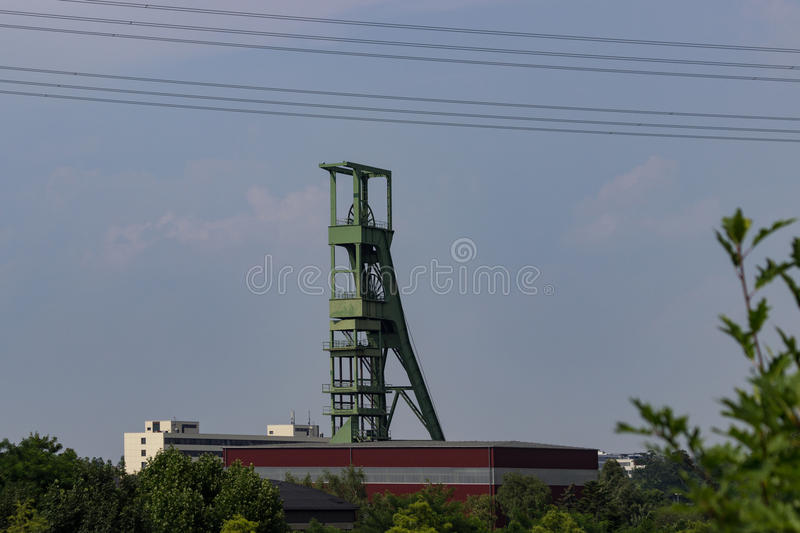 Coal mining tower in front of sky royalty free stock photo