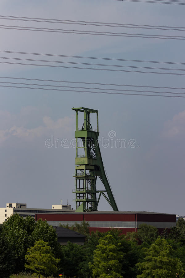 Coal mining tower in front of sky royalty free stock photography