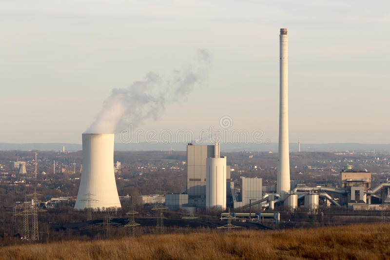 Coal power plant on setting evening sun royalty free stock photography
