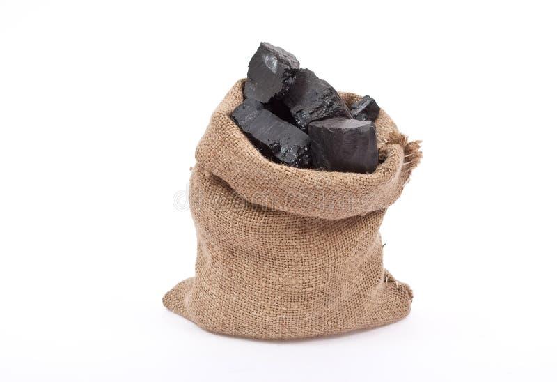 Coal in sack stock image