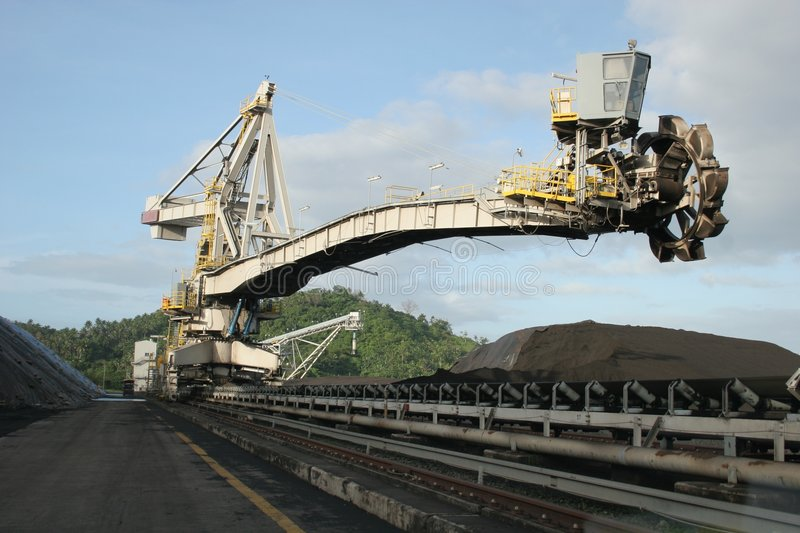 Coal stacker reclaimer. Stacker reclaimer equipment at the coal yar d of a power plant stock photo