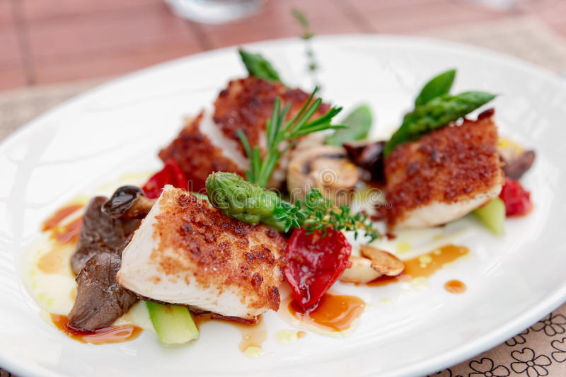 Coalfish fillet with mushrooms and asparagus. On plate royalty free stock image