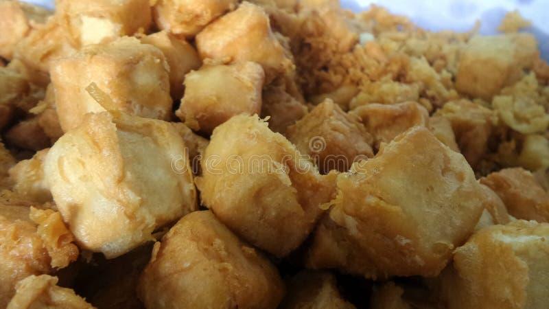 Coalho de feijão fritado comido com molho fotografia de stock