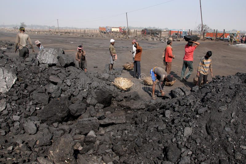 Coalminers in India. October 12,2011 Jharia,Jharkhand,India,Asia-A group of coal mines worker loading coal at the track in Jhariya coalfield area stock image