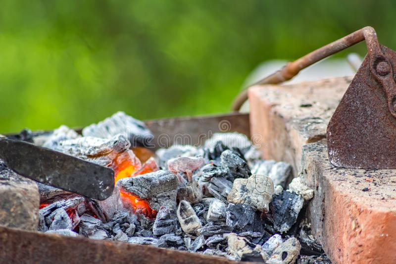 Coals in the smithy in the open air royalty free stock photo