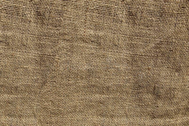 Coarse crumpled burlap texture, background royalty free stock photos
