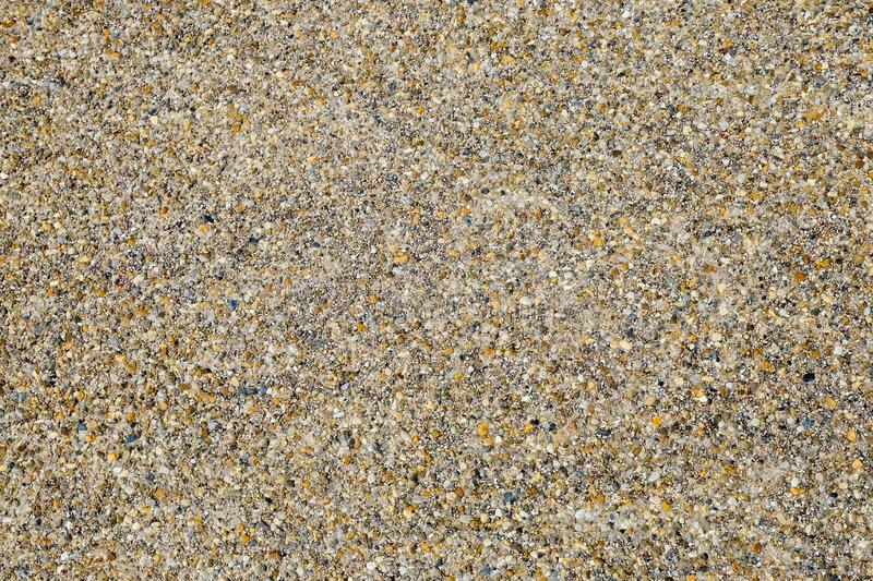 Coarse sand texture for background. Close up, top view royalty free stock photography