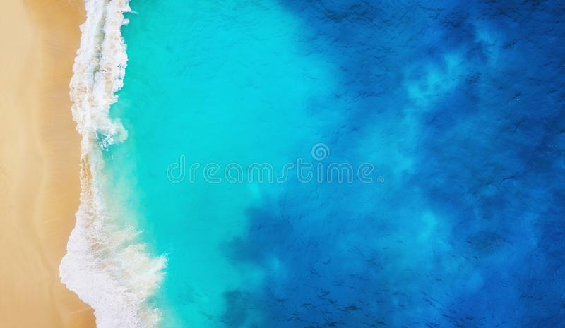 Coast as a background from top view. Turquoise water background from top view. Summer seascape from air. Nusa Penida island, Indon royalty free stock photo