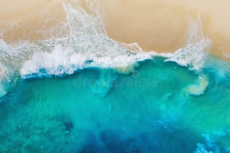Coast as a background from top view. Turquoise water background from top view. Summer seascape from air. Nusa Penida island, Indon stock photography