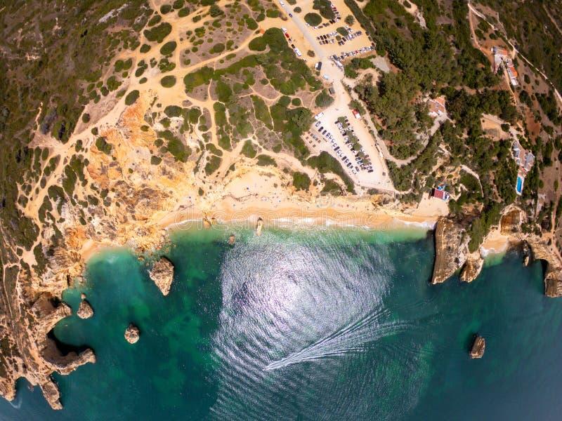 Top view on coast of Atlantic Ocean, beach and cliffs in Praia de Marinha, Algarve Portugal royalty free stock image
