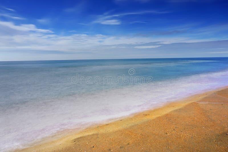 Coast beach with sea waves. Sunny paradise resort. stock photography