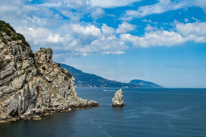 Coast of the Black Sea, Crimea. The view with the blue water and daylight sky with the boat on the horizon stock photos