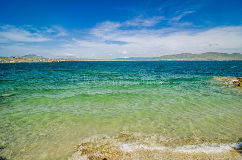 Coast of clear Sevan Lake in Armenian mountains, Armenia royalty free stock photography