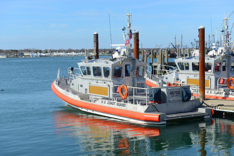 Coast Guard Boat, Narragansett, RI. Point Judith Coast Guard 25-Foot Defender Class Boat docked at pier in the station in Galilee, Narragansett, Rhode Island royalty free stock photo