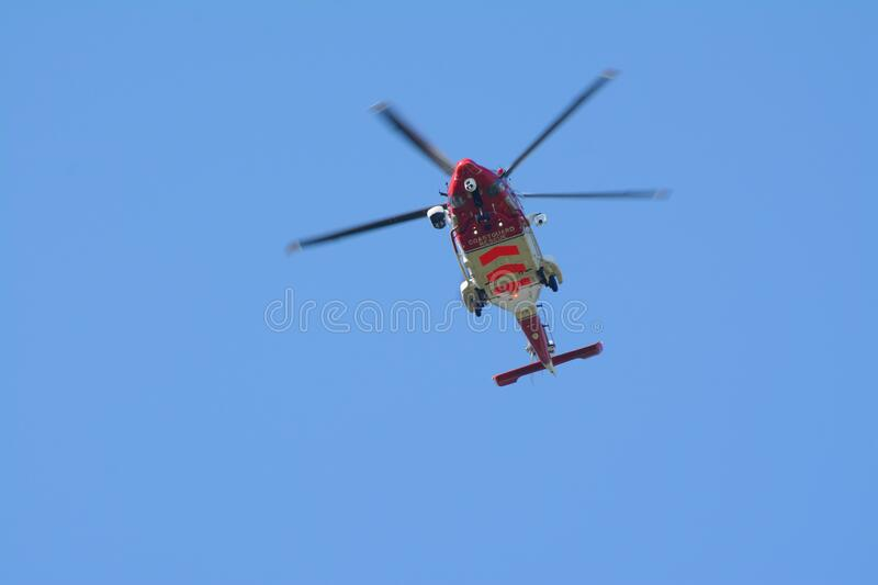 Coast guard helicopter seen from beneath. stock photography