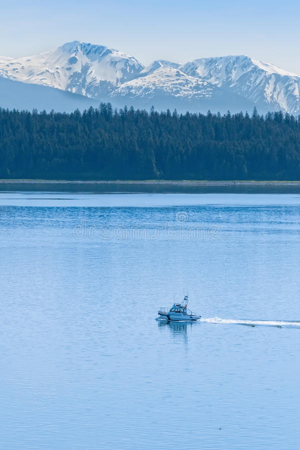 Coast Guard Ship Near Glacier Bay. Coast Guard Ship Patroling Near Glacier Bay National Park, Alaska stock photo