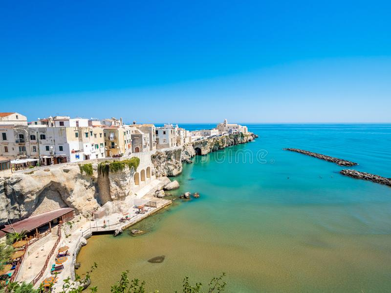The coast and the houses of Vieste, Gargano, Puglia. The coast of Gargano houses numerous beaches and tourist facilities stock photos