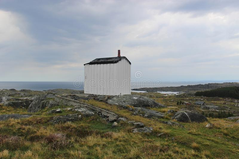 On the coast of the island Utsira in Norway, Europe. A lonely windowless house of unknown function on the coast of Utsira, Norway stock photos