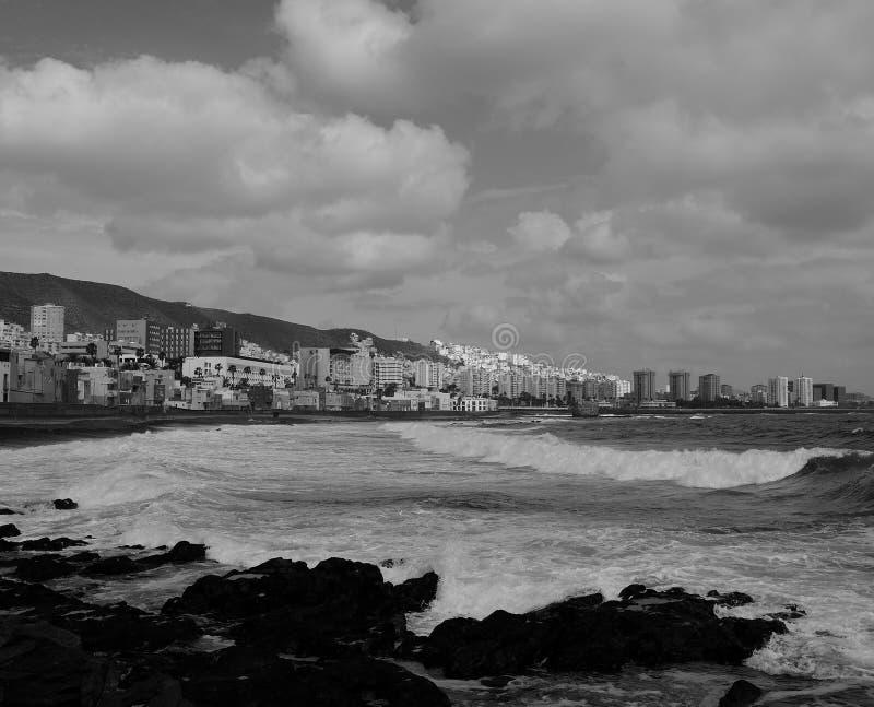 Rocky coast and city, Gran Canaria. Coast of Las Palmas de Gran Canaria with monochrome effect, Canary Islands royalty free stock photos