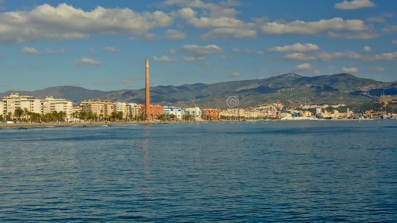Coast of Malaga, with apartment buildings and mountains in the background royalty free stock photos