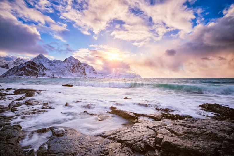 Coast of Norwegian sea on rocky coast in fjord on sunset royalty free stock photos