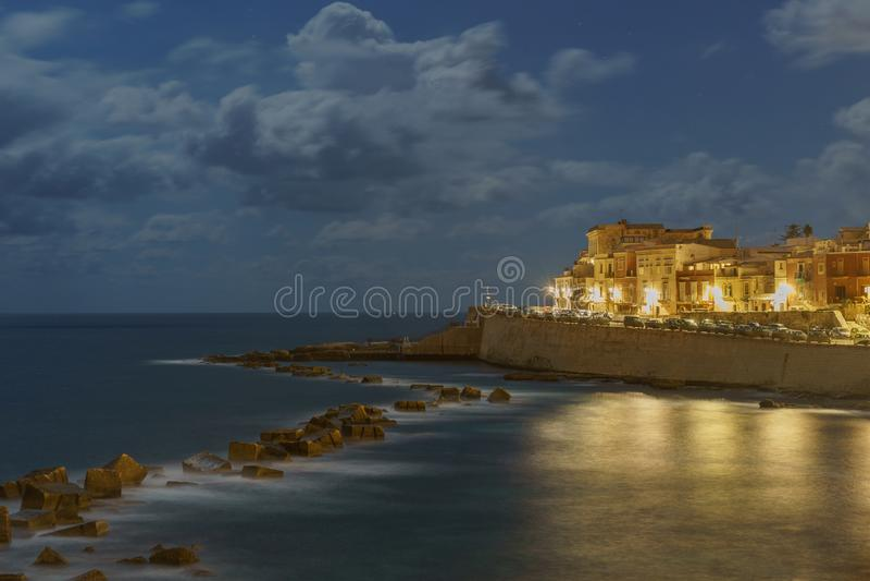 Coast of Ortigia island at city of Syracuse at night Sicily Italy royalty free stock image