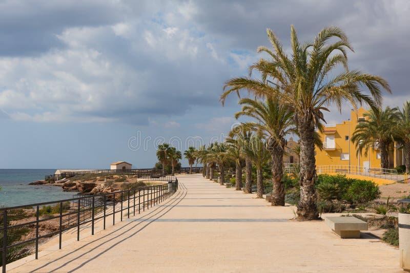 Coast path La Isla Plana Murcia Spain near Our Lady of Carmen church royalty free stock images