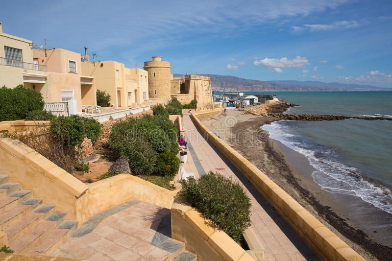 Coast promenade and Roquetas del Mar castle de Santa Ana Costa de Almería, Andalucía Spain. Coast path and Roquetas del Mar castle de Santa Ana Costa de stock image
