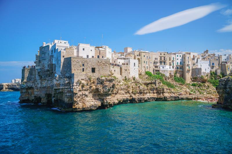 View of sea from Polignano a Mare and beach with tourists, Puglia, Italy. Coast of Polignano a Mare and beach with tourists, Puglia, Italy royalty free stock photography