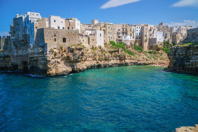 View of sea from Polignano a Mare and beach with tourists, Puglia, Italy. Coast of Polignano a Mare and beach with tourists, Puglia, Italy stock photos