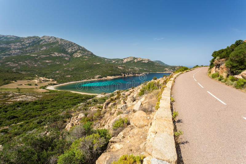 Coast road between Galeria and Calvi in Corsica. Turquoise Mediterranean sea from the D81b coastal road between Galeria and Calvi on the west coast of Corsica royalty free stock photo