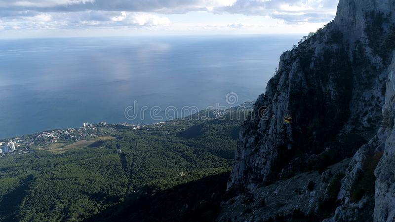 The coast of the sea with a small town near green forest, aerial view from the mountain. Shot. Wonderful seascape and royalty free stock photography