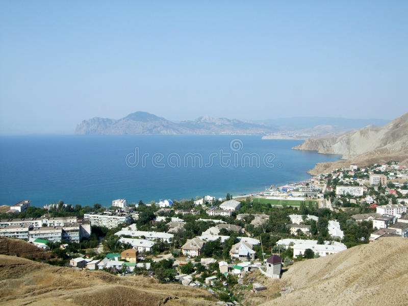 Coast of sea village with hills. Black sea. Crimea Shining royalty free stock image