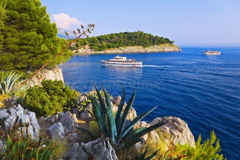 Coast and ship at Makarska, Croatia. Vacations background stock photo