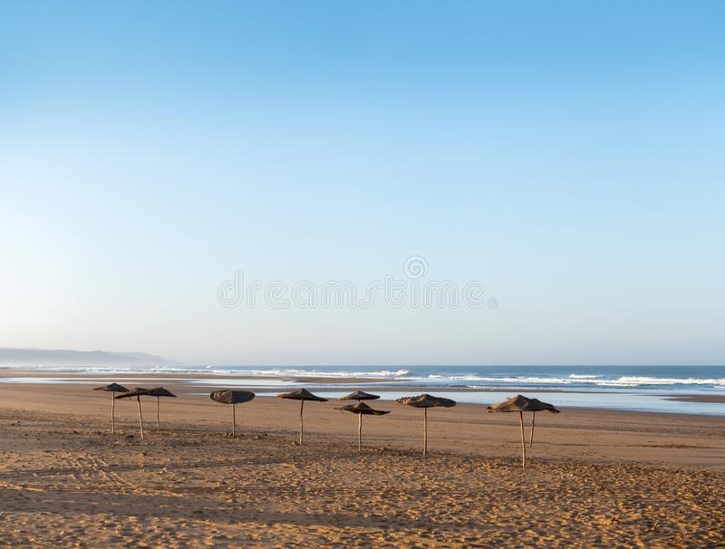 Coast of Sidi Kaouki, Morocco, Africa. Coast with umbrellas. morocco`s wonderfull surf town. Coast of Sidi Kaouki, Morocco, Africa. Coast with umbrellas. morocco royalty free stock photos