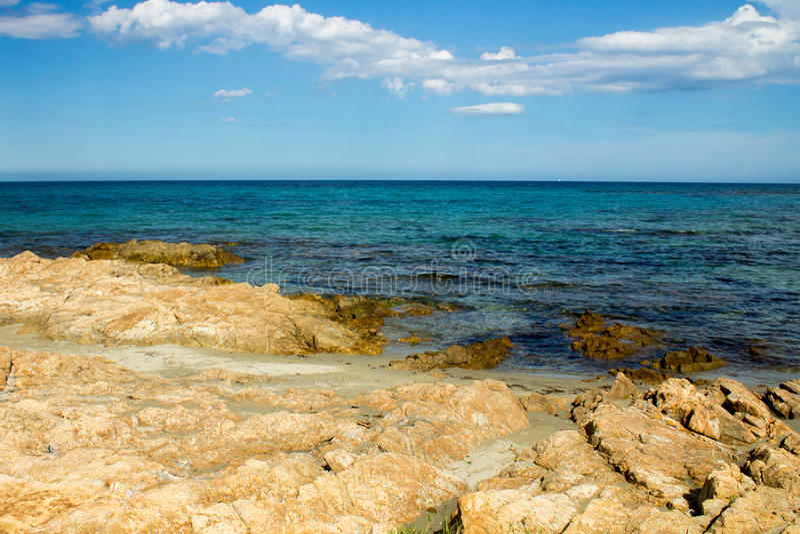 Coast with stones in Sardinia stock photo
