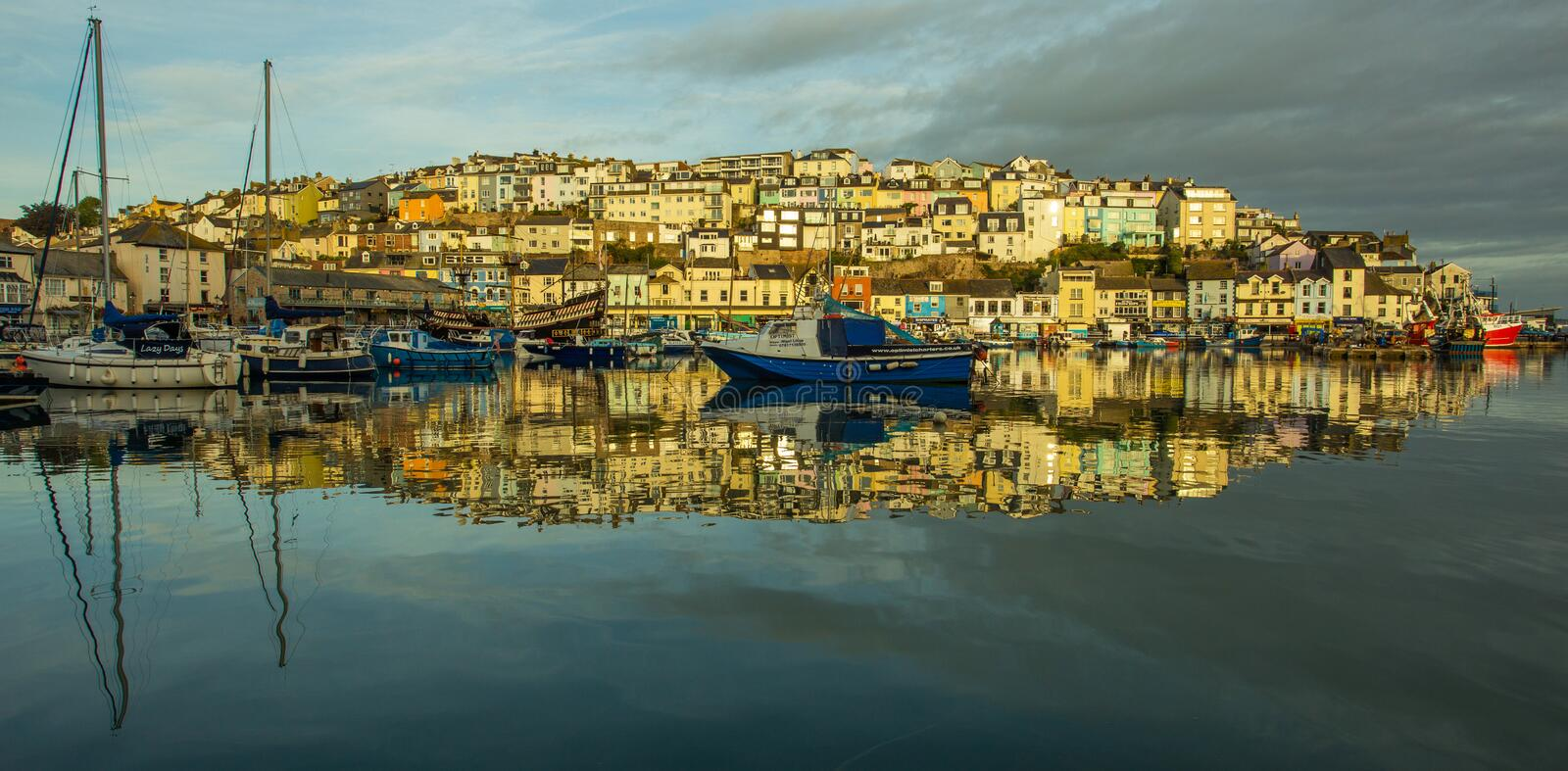 Coast town sunrise water reflections stock photography