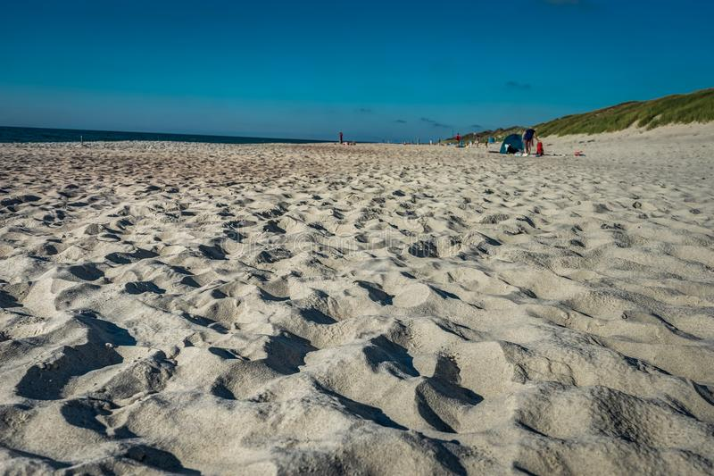 Coastal area in Lithuania Coastal scenery with sandy beach, dunes with marram grass and rough sea on a clear summer day royalty free stock photos