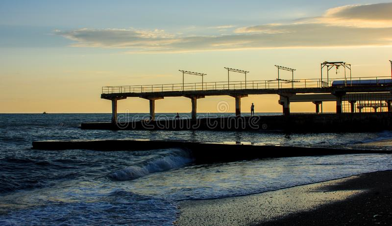 A coastal city dock. At the beach at sunset stock photography