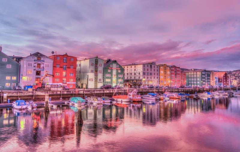 Coastal city at sunrise stock images