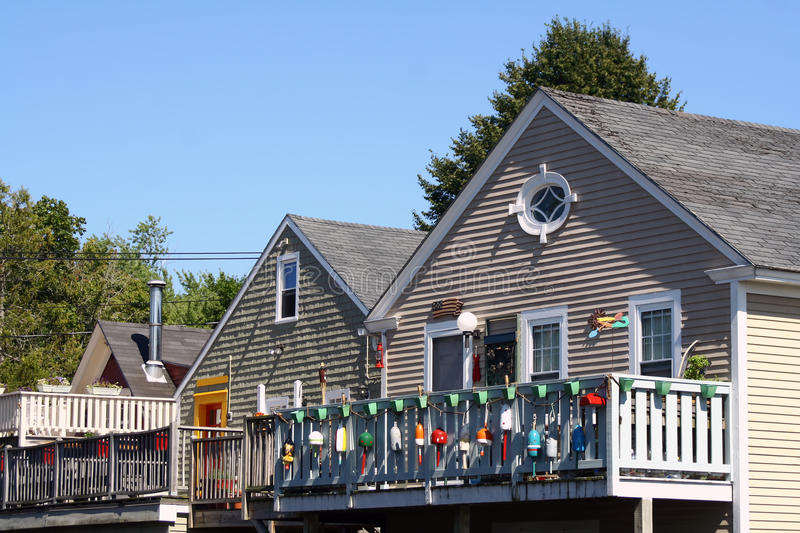 Coastal Cottages. A view of coastal cottages in Kennebunkport, Maine, USA. Kennebunkport is a popular summer area for tourists to visit the seashore stock image