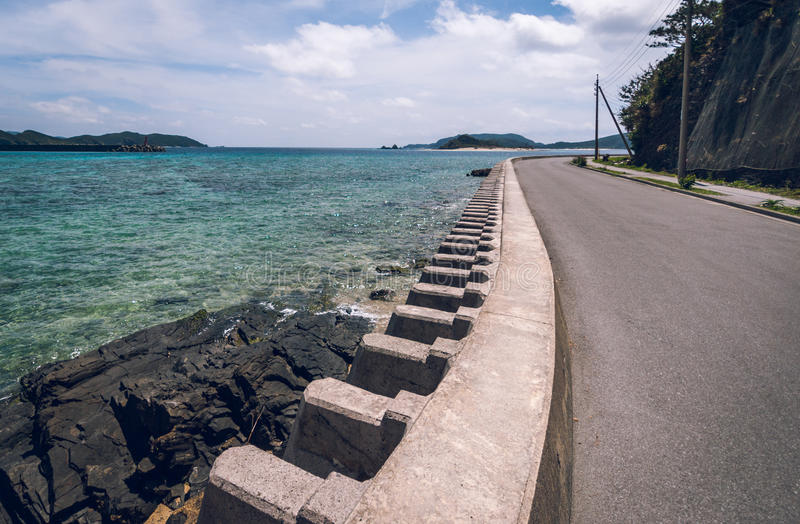 Coastal defence, Okinawa. Coastal defence on Zamami Island protecting the road from the sea royalty free stock images