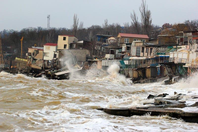 Coastal erosion - houses built on weak clay soil slide down to sea stock photo