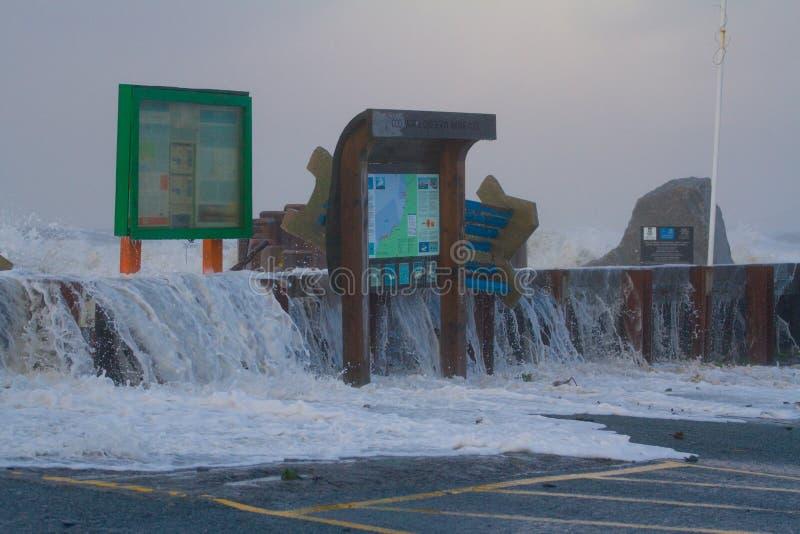 Coastal flooding Borth. Image shows the sea over-topping the sea defences at Borth stock images