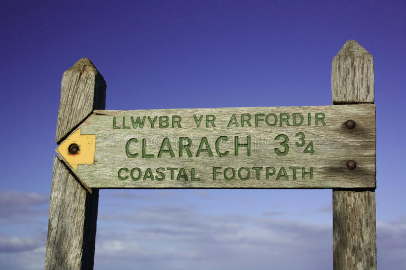 Coastal footpath sign. Close up of a rustic wooden footpath sign from the coastal path in Wales stock images