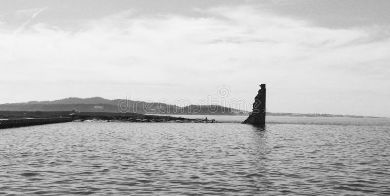 Coastal Harbor Ruins. Remains of a coastal port razed during a storm. These remains are located on the west coast of Spain, the only part that remained standing stock image