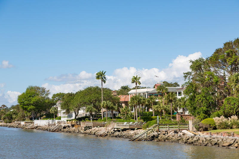 Coastal Homes with Palm Trees and Piers. In Georgia stock photography